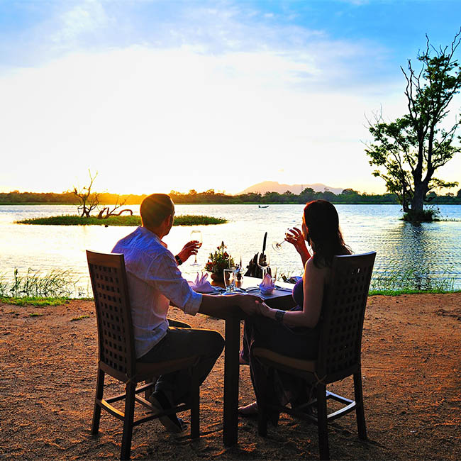 Outdoor dining at Cinnamon Lodge Habarana while enjoying the romantic sunset