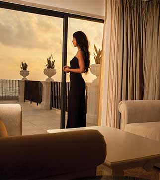 Relishing the glorious sunset & sea view from a luxury suite