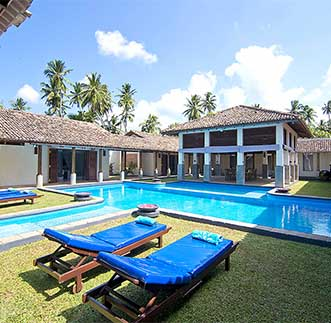 Swimming pool & day beds at Auraliya Resort