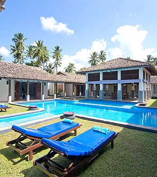 Swimming pool and with day beds at Auraliya Resort