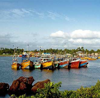 Vividly coloured fishing boats on the Beruwala beach