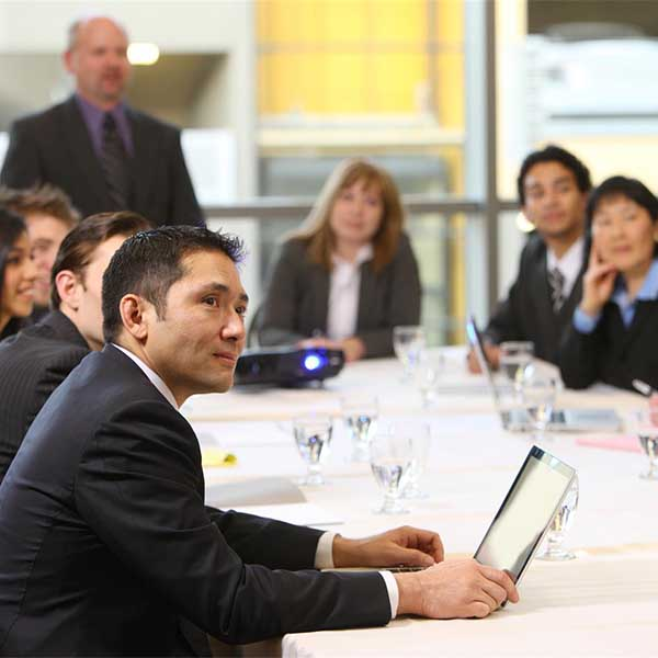 Corporate staff at a board room discussion