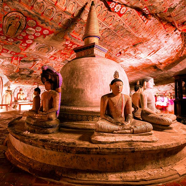 Vivid paintings & statues within the Dambulla Cave Temple