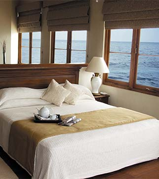Cozy bed of sea view room at The Galle Face Hotel