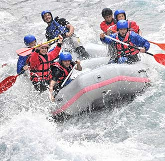 Experiencing thrills of extreme sports- White Water Rafting.