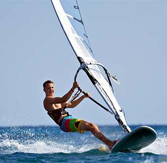 A tourist thrilled by Windsurfing in Sri Lanka