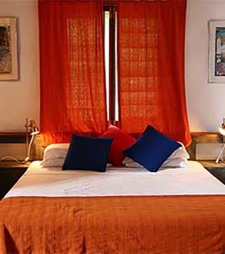 Cozy bedroom with orange and blue interior