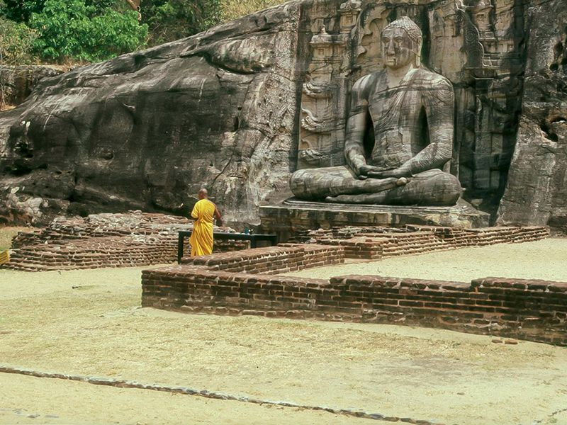A colossal & ancient statue of Lord Buddha at the Gal Pota Temple, Polonnaruwa